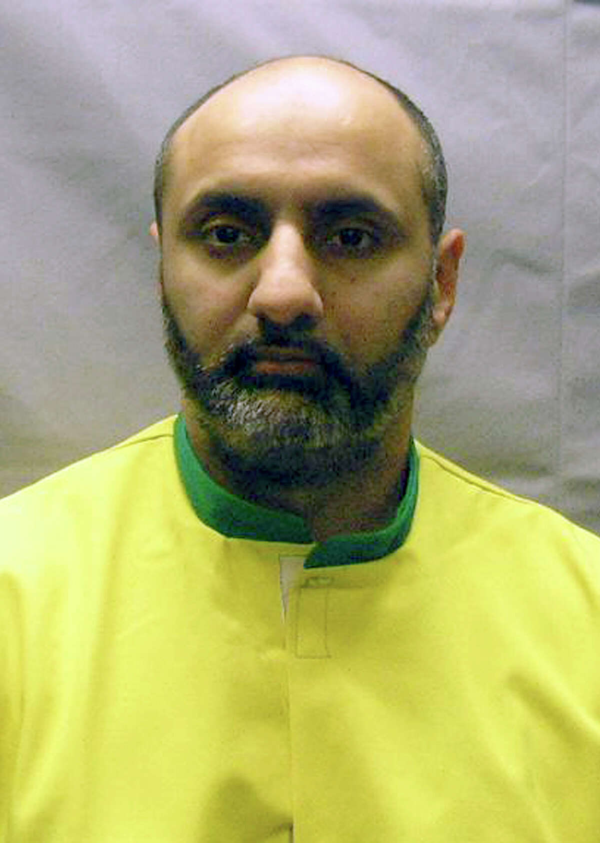 This Nov. 9, 2012 photo provided by the U.S. Attorney's Office shows Babar Ahmad, extradited in October 2012 with Syed Talha Ahsan to the United States from Britain on charges they supported terrorists in Afghanistan and Chechnya by operating websites to raise cash, recruit fighters and solicit items such as gas masks. Ahmad pleaded not guilty on Oct. 6, 2012 and is detained while he awaits trial. Both men have hearings scheduled Tuesday, Dec. 10, 2013, in federal court in New Haven, Conn., to change their pleas. They had previously pleaded not guilty. The two men faced charges in Connecticut, where an Internet service provider was allegedly used to run one of the websites. (AP Photo/U.S. Attorney's Office, File)