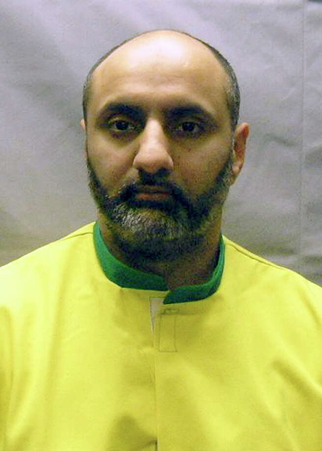 This Nov. 9, 2012 photo provided by the U.S. Attorney's Office shows Babar Ahmad, extradited in October 2012 with Syed Talha Ahsan to the United States from Britain on charges they supported terrorists in Afghanistan and Chechnya by operating websites to raise cash, recruit fighters and solicit items such as gas masks. Ahmad pleaded not guilty on Oct. 6, 2012 and is detained while he awaits trial.  Both men have hearings scheduled Tuesday, Dec. 10, 2013, in federal court in New Haven, Conn., to change their pleas. They had previously pleaded not guilty. The two men faced charges in Connecticut, where an Internet service provider was allegedly used to run one of the websites. (AP Photo/U.S. Attorney's Office, File) Photo: Uncredited, ASSOCIATED PRESS / Connecticut Post contributed