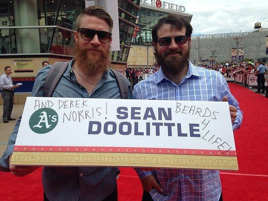 The A's Sean Doolittle and Derek Norris with the sign doctored to announce Norris' presence at the All-Star parade. Photo: Eireann Dolan