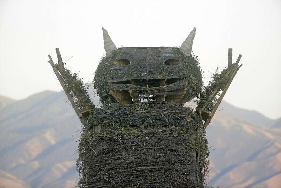 """Suicidal leap:Police say Salt Lake City resident Christopher Wallace died after jumping into the burning, three-story-tall effigy of a character (shown here before it was torched) from the classic children's book,   """"Where the Wild Things Are,"""" during the Element 11 festival. The event in   Grantsville, Utah, is similar to Burning Man. Photo: Rick Bowmer, Associated Press"""