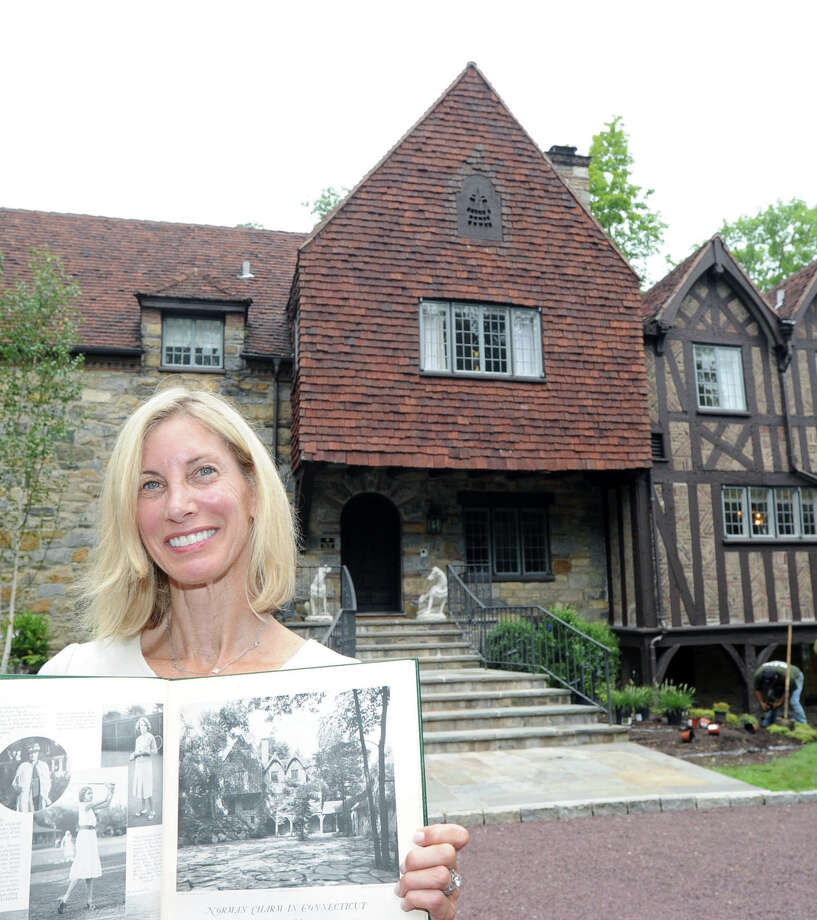Robin Kencel holds the January 19, 1934 issue of Country Life that featured photos and an article about the home that now belongs to her and husband, Kenneth Kencel, at 44 Khakum Wood Road in Greenwich, Conn., Tuesday, July 15, 2014. The home was recognized in April by the Greenwich Historical Society's 2014 Landmark Recognition Program and received a plaque. According to Kencel the home was originally landscaped by the Olmsted Brothers, whose father, Frederick Law Olmsted, designed Central Park in New York. Photo: Bob Luckey / Greenwich Time