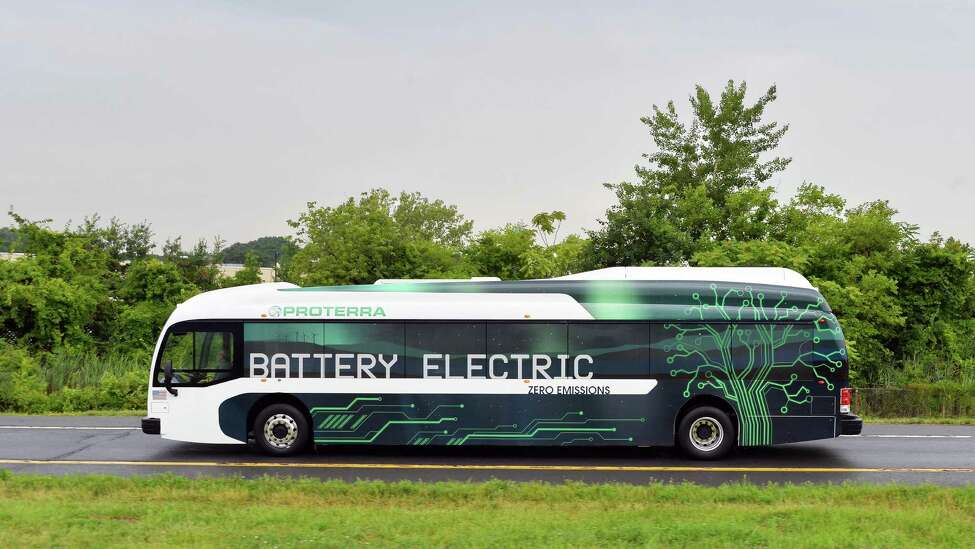 Proterra's full-size, 40-foot Electric bus exits I-787 on its way to an informational stop on Washington Ave. Tuesday, July 15, 2014, in Albany, N.Y. (John Carl D'Annibale / Times Union)
