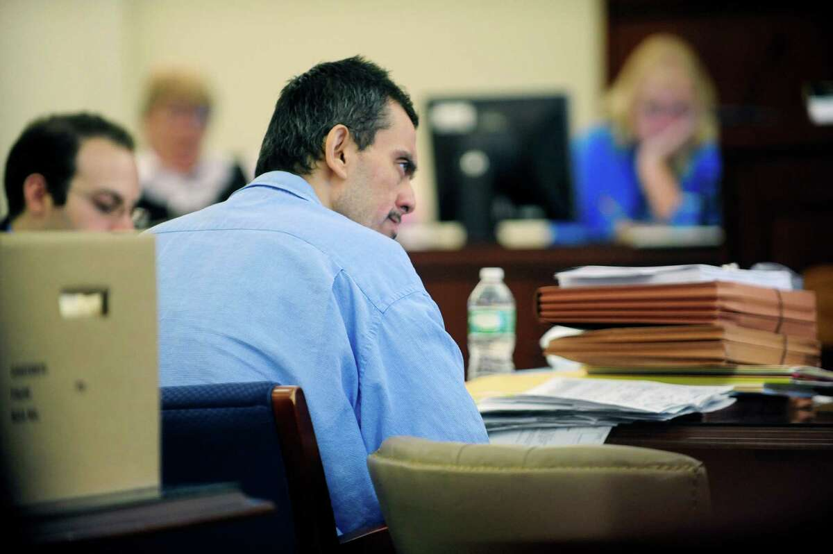 Pablo Cruz listens as an assistant district attorney gives the prosecution's opening arguments in Cruz's trial Tuesday, July 15, 2014, at the Albany County Judicial Center in Albany, N.Y. Cruz is accused of hitting and killing Paul Merges Jr. at an Albany intersection as Cruz tried to drive away from police. (Paul Buckowski / Times Union)