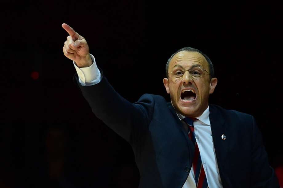 CSKA Moscow's Italian coach Ettore Messina gestures during the Euroleague semifinal match CSKA Moscow vs Maccabi Electra Tel-Aviv on May 16, 2014 at the Mediolanum Forum  in Assago. Photo: GIUSEPPE CACACE, AFP/Getty Images