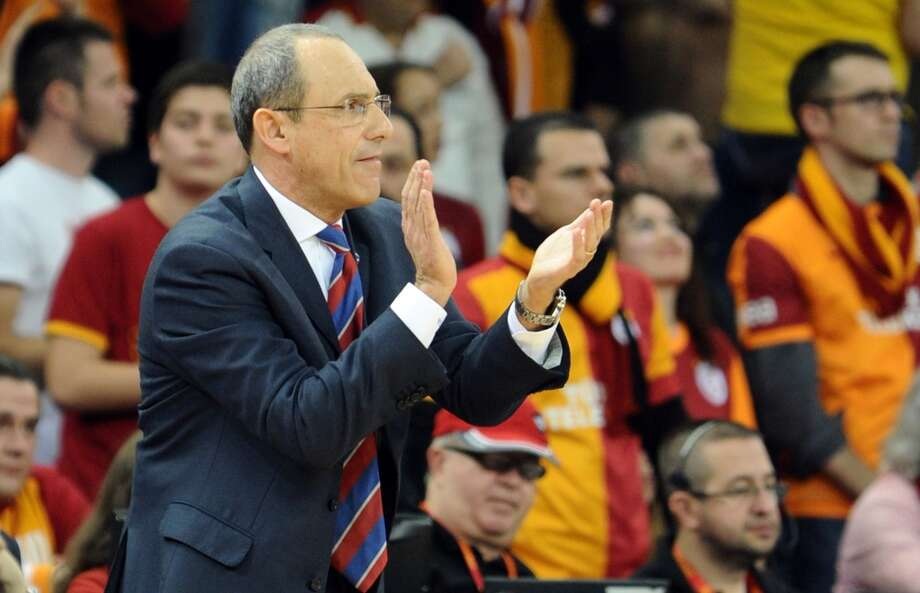 CSKA Moskow's head coach Ettore Messina claps during a Euroleague Top 16 group F basket match between Galatasaray and CSKA Moskow on February 14, 2014, at Abdi Ipekci Arena in Istanbul. Photo: OZAN KOSE, AFP/Getty Images