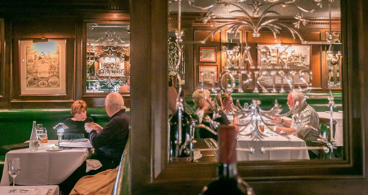 People have dinner in the dining room at the Big 4 restaurant in San Francsico, Calif. on Thursday, July 10th, 2014.