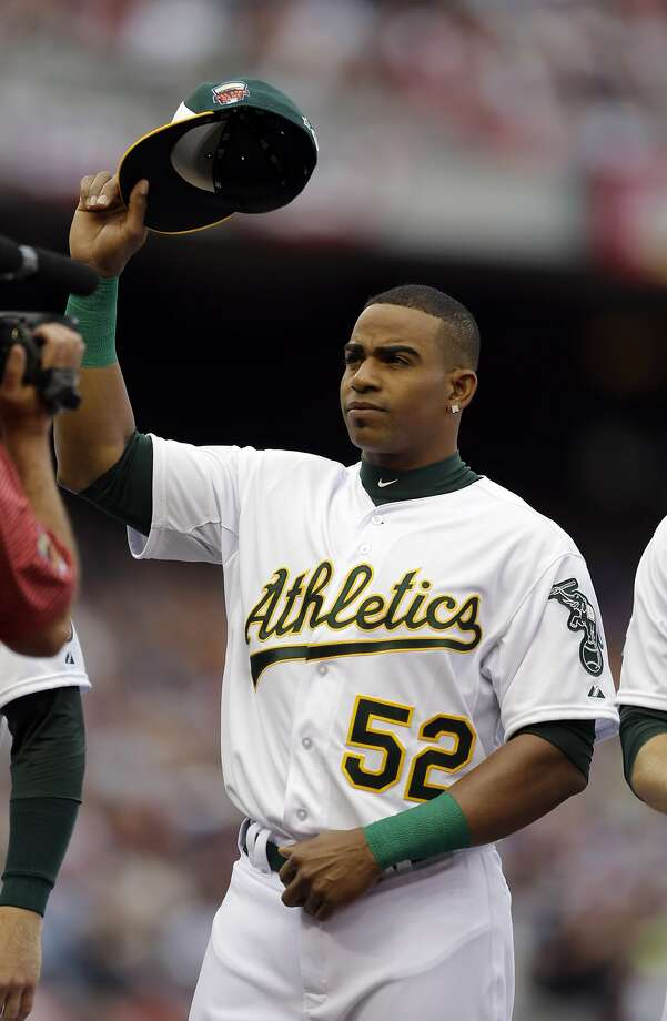 American League outfielder Yoenis Cespedes, of the Oakland Athletics, waves to the crowd before the MLB All-Star Game. Photo: Jeff Roberson, Associated Press
