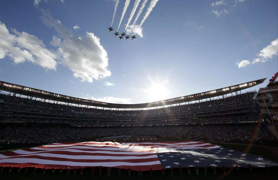 The U.S. national anthem is played before the MLB All-Star baseball game, Tuesday, July 15, 2014, in Minneapolis. (AP Photo/Paul Sancya) Photo: Paul Sancya, Associated Press