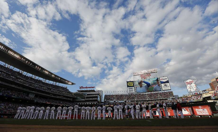 American League players stand on the field during introductions before the MLB All-Star Game. Photo: Jeff Roberson, Associated Press
