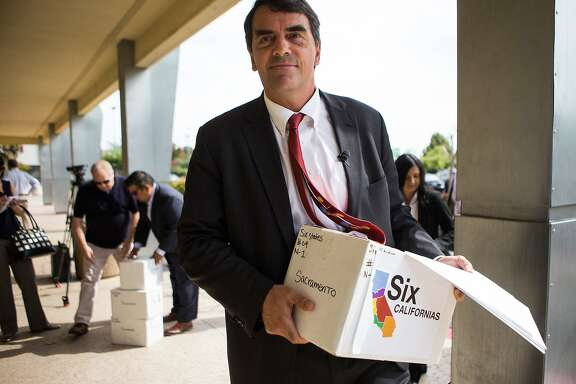 Venture capitalist Tim Draper delivers signed petitions to divide California into six separate states at the County of Sacramento Voter Registration and Elections Department in Sacramento, California, July 15, 2014.