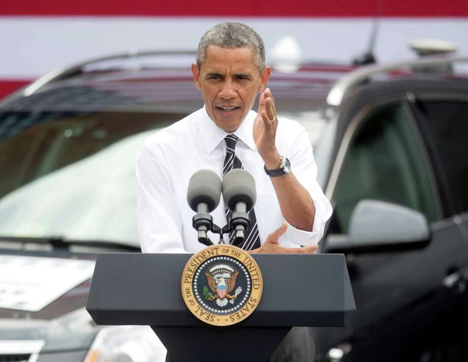 President Barack Obama speaks about the economy at the Turner-Fairbank Highway Research Center in McLean, Va., Tuesday, July 15, 2014. President Barack Obama envisions a time when cars will be able to talk with other cars or with America's roads. He says such technology could prevent crashes, cut down on traffic and save gasoline. (AP Photo/Pablo Martinez Monsivais) ORG XMIT: VAPM104 Photo: Pablo Martinez Monsivais / AP