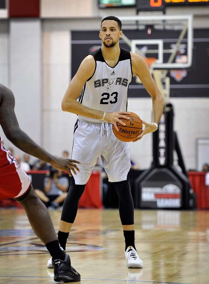 San Antonio Spurs's Austin Daye looks to pass against the Cleveland Cavaliers during an NBA summer league basketball game on Sunday, July 13, 2014, in Las Vegas. Photo: DAVID BECKER, For The San Antonio Express-News