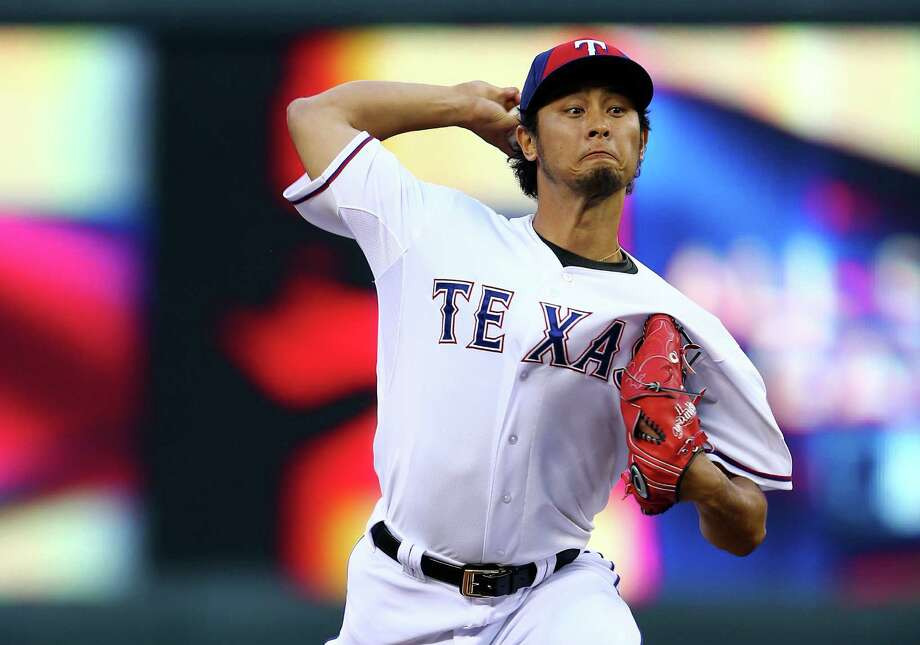MINNEAPOLIS, MN - JULY 15:  American League All-Star Yu Darvish #11 of the Texas Rangers pitches against the National League All-Stars in the third inning during the 85th MLB All-Star Game at Target Field on July 15, 2014 in Minneapolis, Minnesota. Photo: Elsa, Getty Images / 2014 Getty Images