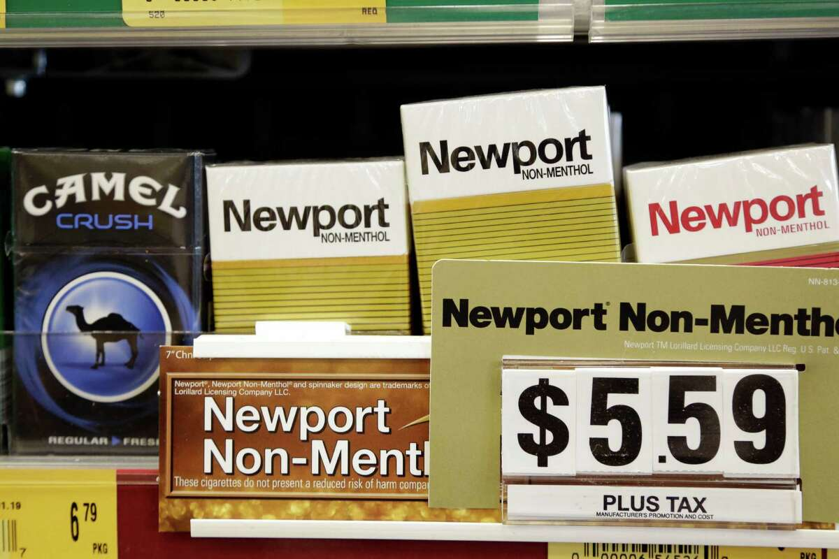 Camel, a Reynolds American brand, and Newport, a Lorillard brand, cigarettes are displayed for sale, Tuesday, July 15, 2014, in Doral, Fla. Cigarette maker Reynolds American Inc. is planning to buy rival Lorillard Inc. for about $25 billion in a deal to combine two of the nation's oldest and biggest tobacco companies. (AP Photo/Lynne Sladky)