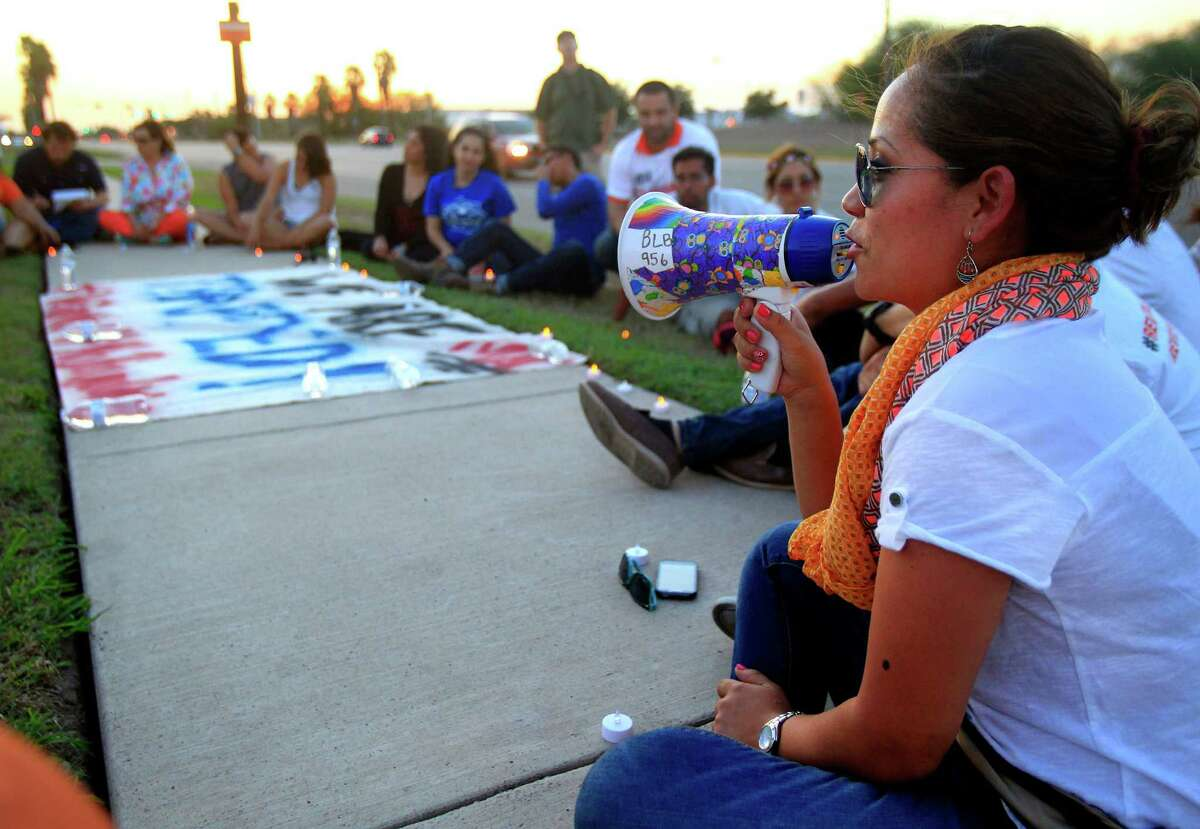Lupita Lopez, right, talks about her support during a vigil to support immigration issues on the border and after Jose Antonio Vargas, Pulitzer Prize-winning journalist and an activist for immigrants, was arrested Tuesday July 15, 2014 in McAllen. Photo by Gabe Hernandez