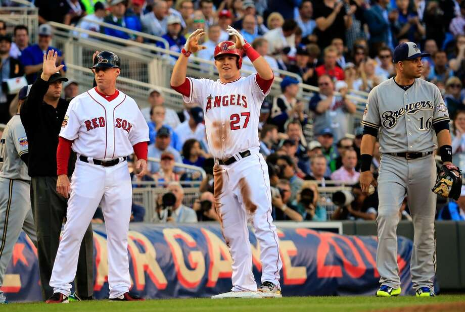 American League All-Star Mike Trout #27 of the Angels reaches third base with a triple in the first inning. Photo: Rob Carr, Getty Images