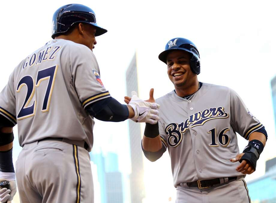 National League All-Star Aramis Ramirez #16 of the Brewers celebrates with teammate Carlos Gomez #27  after scoring. Photo: Elsa, Getty Images