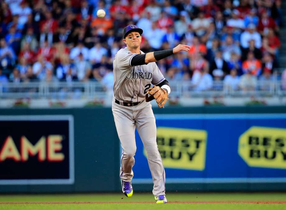 National League All-Star Troy Tulowitzki #2 of the Rockies throws to first base. Photo: Rob Carr, Getty Images