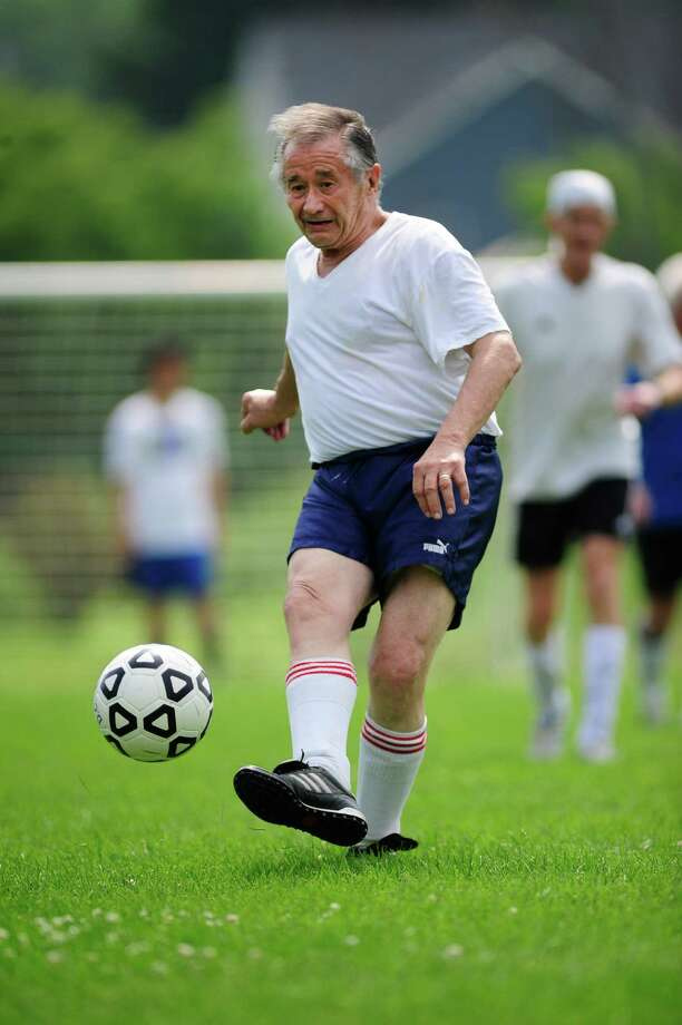 82-year-old Ramon Fabregas plays soccer with a group of men on Sunday, July 13, 2014, in Cohoes, N.Y.  (Paul Buckowski / Times Union) Photo: Paul Buckowski / 00027759A