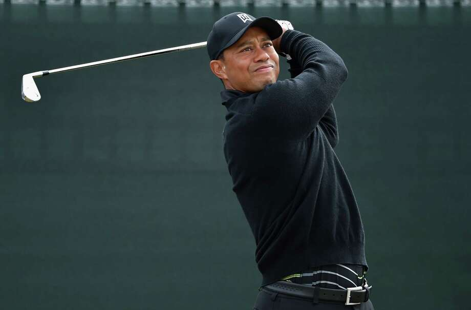 HOYLAKE, ENGLAND - JULY 15:  Tiger Woods of the United States tees off during a practice round prior to the start of The 143rd Open Championship at Royal Liverpool on July 15, 2014 in Hoylake, England.  (Photo by Stuart Franklin/Getty Images) ORG XMIT: 497278045 Photo: Stuart Franklin / 2014 Getty Images