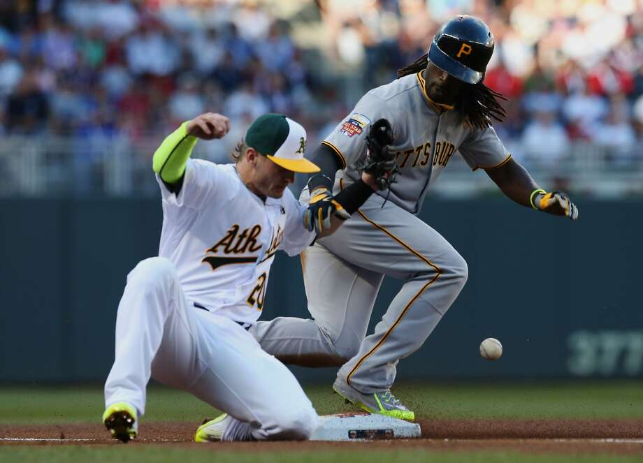 National League outfielder Andrew McCutchen, of the Pittsburgh Pirates, steals third base as American League Josh Donaldson, of the Oakland Athletics, tries to make the tag during the first inning of the MLB All-Star baseball game, Tuesday, July 15, 2014, in Minneapolis. (AP Photo/Jim Mone) Photo: Jim Mone, Associated Press