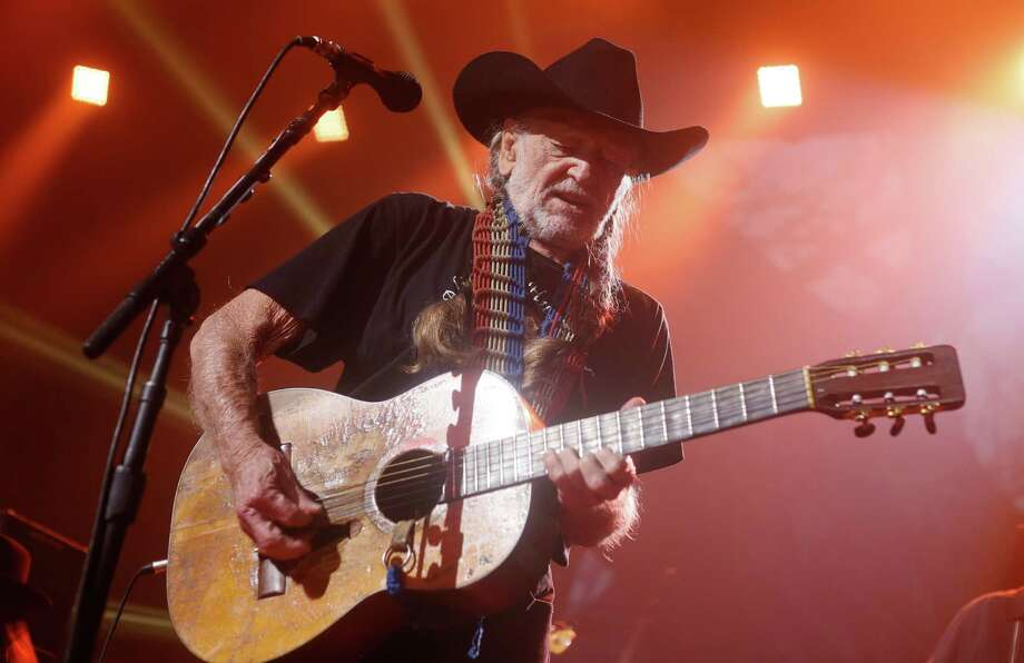 """Willie Nelson has a few thoughts about the flow of migrant children coming over the U.S.-Mexico border and how to deal with them. """"I've been watching, and the only thing we can do is take care of those kids, whatever it takes,"""" Nelson told Rolling Stone. """"Take them in, give them some medical attention. I'm sure there are homes all over the country that would be glad to take care of one or two kids."""" FILE - In this March 15, 2014 file photo, Willie Nelson performs at the iTunes Festival during the SXSW Music Festival in Austin, Texas. University of Texas' Dolph Briscoe Center for American History on Thursday, May 8, 2014 announced that Nelson has donated many of his platinum records, manuscripts and creative documents to UT. The Willie Nelson Collection in Austin will be the focus of an upcoming exhibit. (Photo by Jack Plunkett/Invision/AP, File) Photo: Jack Plunkett, Invision/Associated Press / Invision"""
