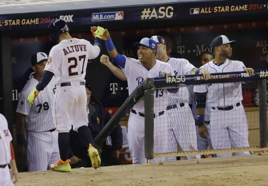 AL 5, NL 3  American League's Jose Altuve, of the Astros, celebrates with teammates after a sac fly in the fifth inning. Photo: Paul Sancya, Associated Press