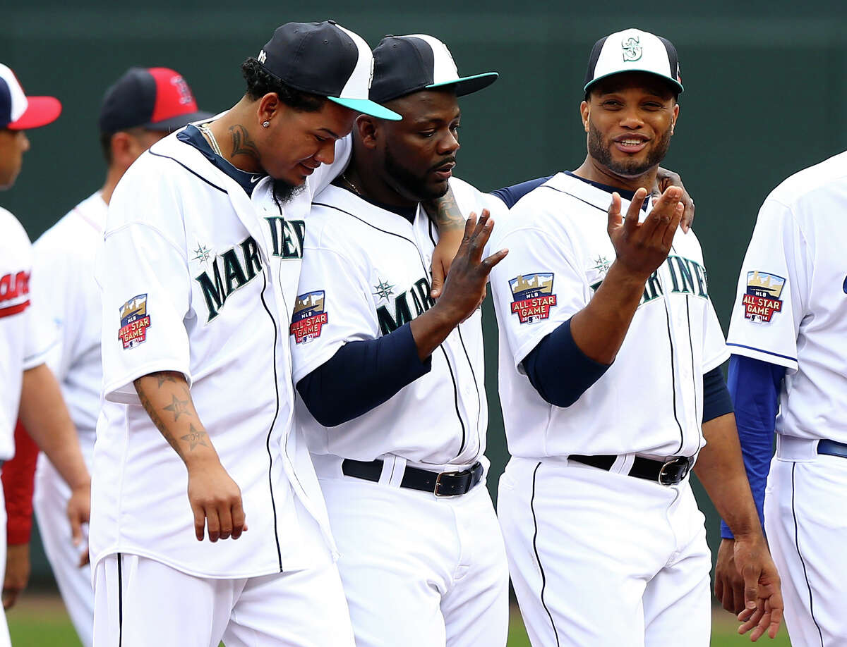 MINNEAPOLIS, MN - JULY 15: American League All-Stars Felix Hernandez #34, Fernando Rodney #56, and Robinson Cano #24 of the Seattle Mariners walk off the field prior to the 85th MLB All-Star Game at Target Field on July 15, 2014 in Minneapolis, Minnesota.