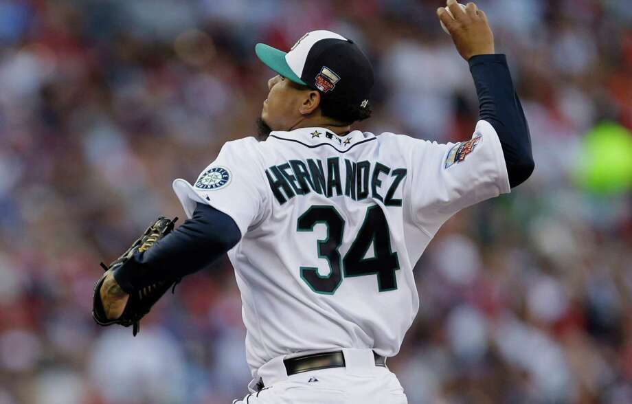 American League starting pitcher Felix Hernandez, of the Seattle Mariners, throws  during the first inning of the MLB All-Star baseball game, Tuesday, July 15, 2014, in Minneapolis. Photo: Jeff Roberson, AP / AP