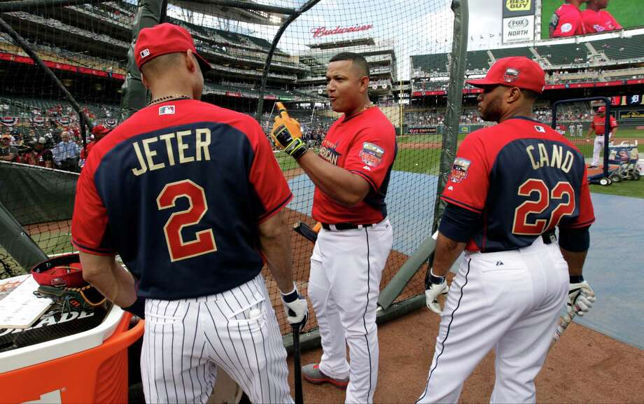 American League first baseman Miguel Cabrera, of the Detroit Tigers, center, talks with teammates shortstop Derek Jeter, of the New York Yankees, left, and second baseman Robinson Cano, of the Seattle Mariners, right, outside the batting cage before the MLB All-Star baseball game, Tuesday, July 15, 2014, in Minneapolis. Photo: Paul Sancya, AP / AP