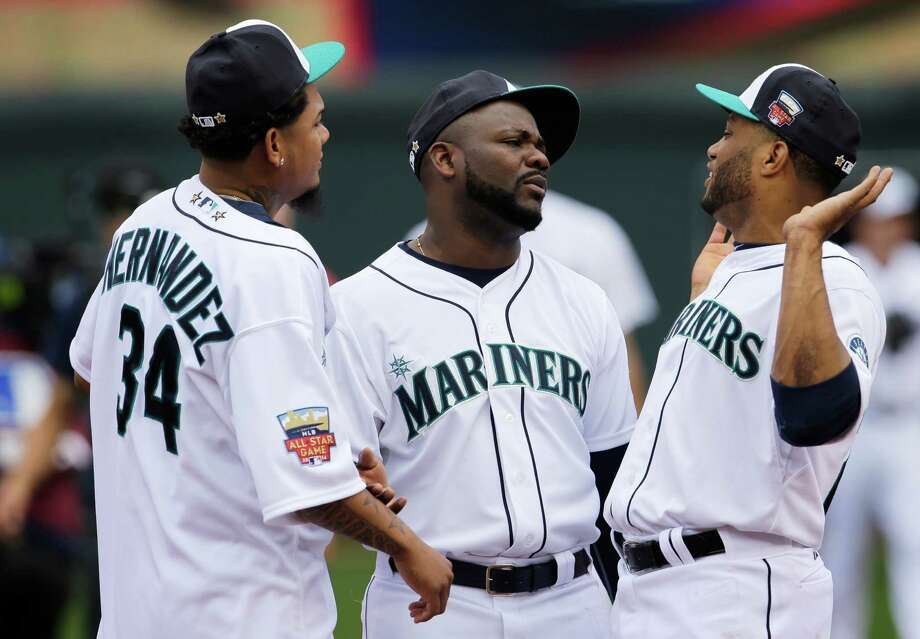American League players, from left, Felix Hernandez, Fernando Rodney and Robinson Cano, all of the Seattle Mariners, talk on the field before the MLB All-Star baseball game, Tuesday, July 15, 2014, in Minneapolis. Photo: Paul Sancya, AP / AP2014