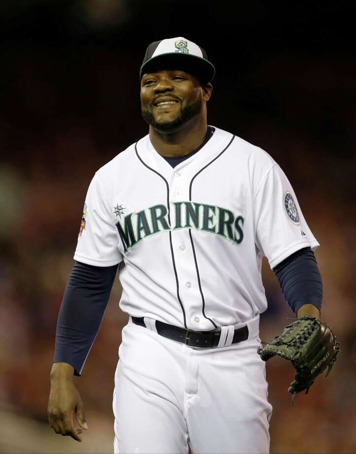 American League pitcher Fernando Rodney, of the Seattle Mariners, reacts after striking out National League's Daniel Murphy, of the New York Mets, to end the eighth inning of the MLB All-Star baseball game, Tuesday, July 15, 2014, in Minneapolis. Photo: Jeff Roberson, AP / AP2014