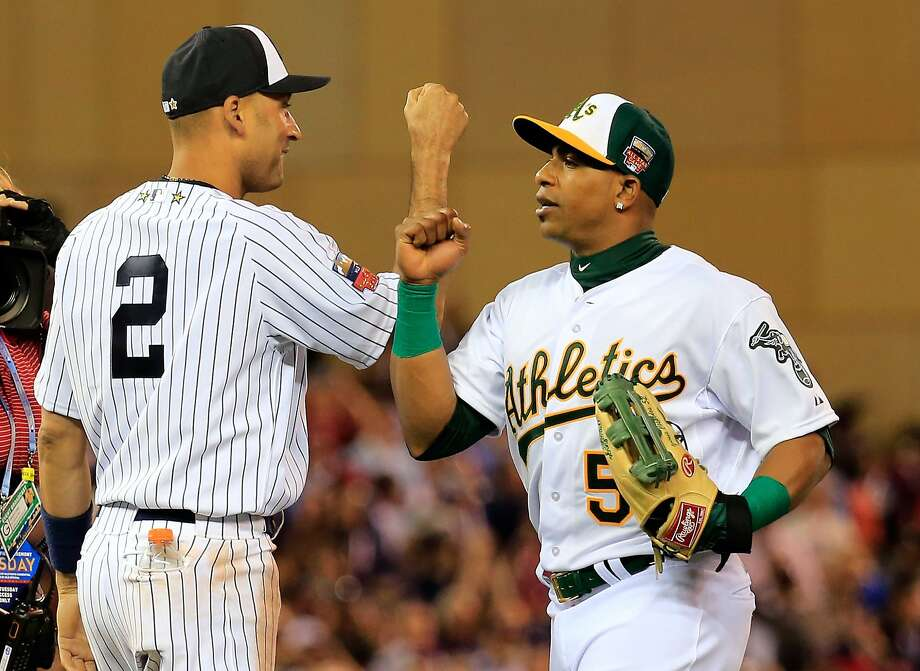 American League All-Stars Derek Jeter and Yoenis Cespedes celebrate a 5-3 victory over the National League All-Stars during the 85th MLB All-Star Game at Target Field on July 15, 2014 in Minneapolis. Photo: Rob Carr, Getty Images