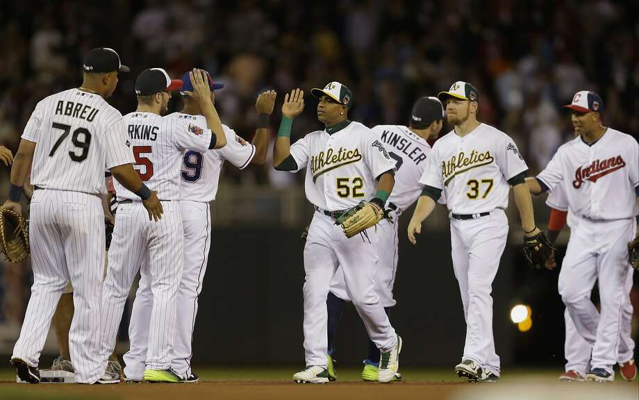 American League players celebrate after their 5-3 victory over the National League. Photo: Jeff Roberson, Associated Press