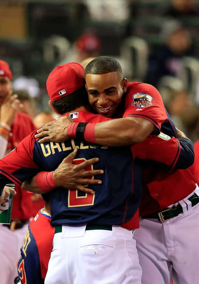 MINNEAPOLIS, MN - JULY 14:  American League All-Star Yoenis Cespedes #52 of the Oakland A's celebrates with coach Mike Gallego, who threw to him in competition, after winning the Gillette Home Run Derby at Target Field on July 14, 2014 in Minneapolis, Minnesota.  (Photo by Rob Carr/Getty Images) Photo: Rob Carr, Getty Images