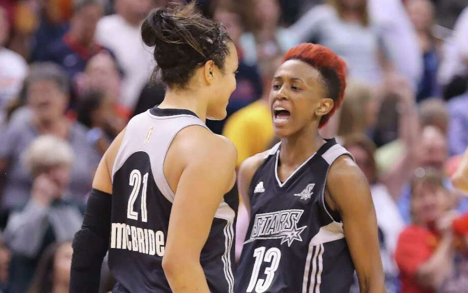 Danielle Robinson (13), celebrating with rookie Kayla McBride after the latter hit a game-winning basket, was voted to the West All-Star team as a reserve for the second straight season. Photo: Rob Goebel / Indianapolis Star