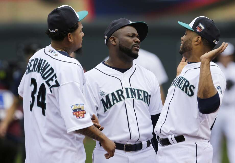 American League players, from left, Felix Hernandez, Fernando Rodney and Robinson Cano, all of the Seattle Mariners, talk on the field before the MLB All-Star baseball game, Tuesday, July 15, 2014, in Minneapolis. (AP Photo/Paul Sancya) Photo: ASSOCIATED PRESS