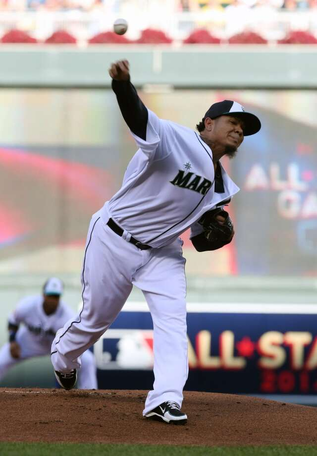 American League pitcher Felix Hernandez, of the Seattle Mariners, delivers the ball during the first inning of the MLB All-Star baseball game, Tuesday, July 15, 2014, in Minneapolis. (AP Photo/Jim Mone) Photo: ASSOCIATED PRESS