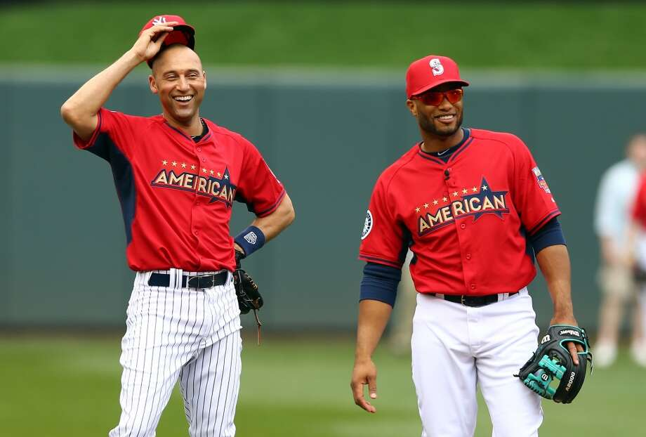 MINNEAPOLIS, MN - JULY 15:  American League All-Star Derek Jeter #2 of the New York Yankees speaks with American League All-Star Robinson Cano #24 of the Seattle Mariners during batting practice prior to the 85th MLB All-Star Game at Target Field on July 15, 2014 in Minneapolis, Minnesota.  (Photo by Elsa/Getty Images) Photo: Getty Images