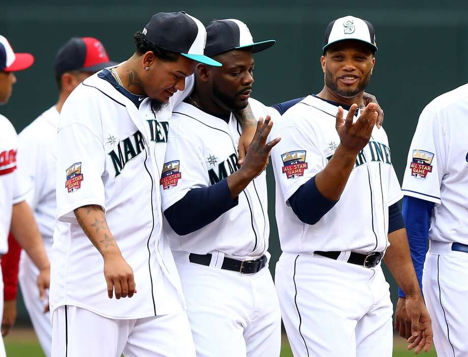 MINNEAPOLIS, MN - JULY 15: American League All-Stars Felix Hernandez #34, Fernando Rodney #56, and Robinson Cano #24 of the Seattle Mariners walk off the field prior to the 85th MLB All-Star Game at Target Field on July 15, 2014 in Minneapolis, Minnesota.  (Photo by Elsa/Getty Images) Photo: Getty Images