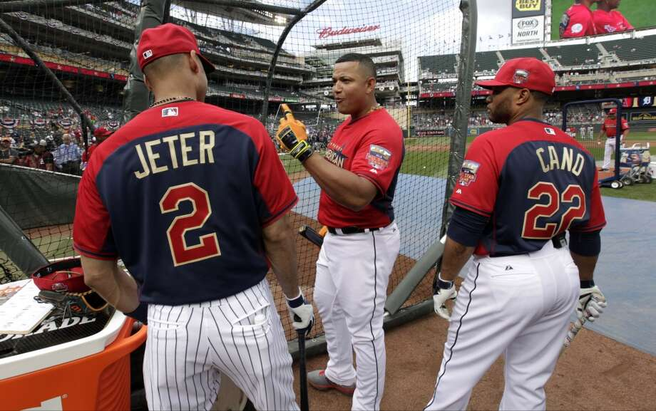 American League first baseman Miguel Cabrera, of the Detroit Tigers, center, talks with teammates shortstop Derek Jeter, of the New York Yankees, left, and second baseman Robinson Cano, of the Seattle Mariners, right, outside the batting cage before the MLB All-Star baseball game, Tuesday, July 15, 2014, in Minneapolis. (AP Photo/Paul Sancya) Photo: AP