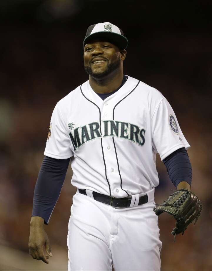 American League pitcher Fernando Rodney, of the Seattle Mariners, reacts after striking out National League's Daniel Murphy, of the New York Mets, to end the eighth inning of the MLB All-Star baseball game, Tuesday, July 15, 2014, in Minneapolis. (AP Photo/Jeff Roberson) Photo: ASSOCIATED PRESS