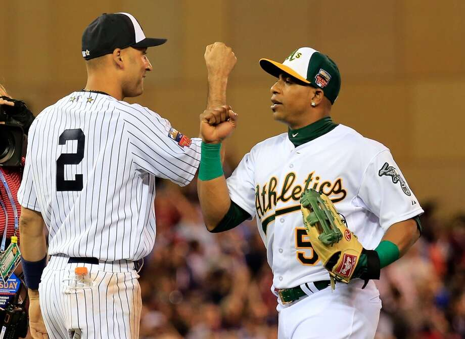 American League All-Stars Derek Jeter #2 of the Yankees and Yoenis Cespedes #52 of the Athletics celebrate the AL victory. Photo: Rob Carr, Getty Images