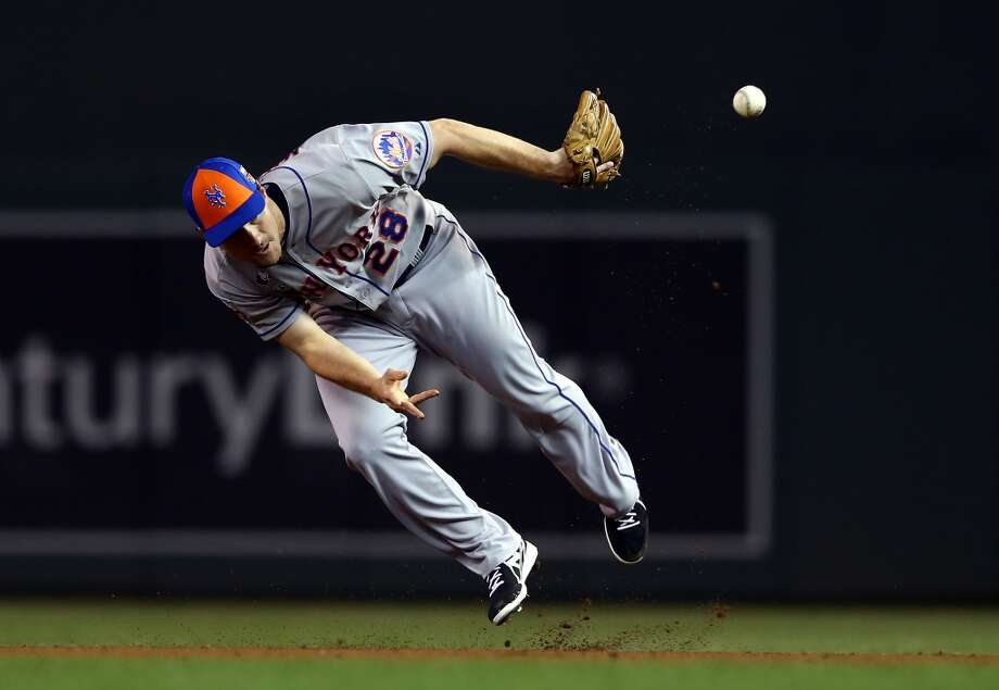 National League All-Star Daniel Murphy of the Mets makes a defensive play. Photo: Elsa, Getty Images