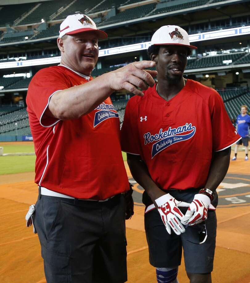 Patrick Beverley chats with Roger Clemens. Photo: Karen Warren, Houston Chronicle
