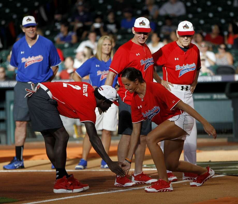 Cat Osterman and Patrick Beverley low-five during player introductions. Photo: Karen Warren, Houston Chronicle
