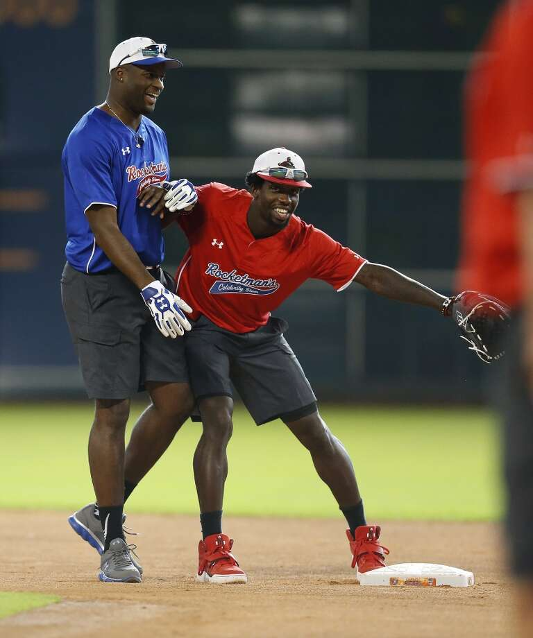 Vince Young goofs around on second base with Patrick Beverley. Photo: Karen Warren, Houston Chronicle