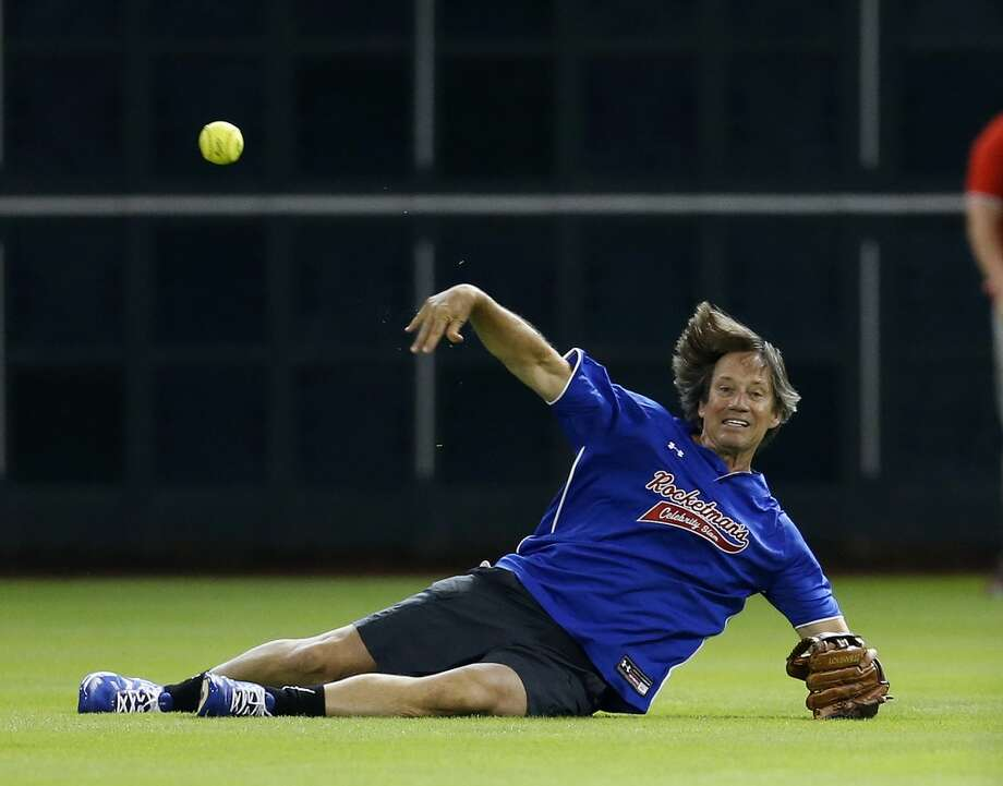 Kevin Sorbo fields the single hit by Toby Keith. Photo: Karen Warren, Houston Chronicle