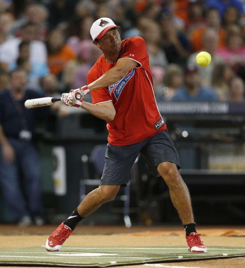Brian Ching hits the ball. Photo: Karen Warren, Houston Chronicle