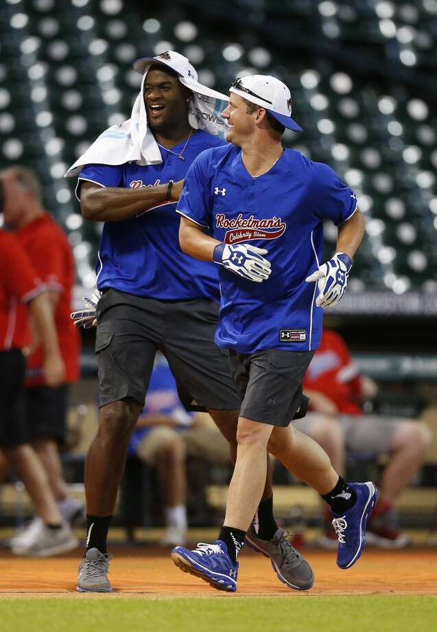 Vince Young celebrates with Roy Oswalt as he runs the bases after his home run. Photo: Karen Warren, Houston Chronicle